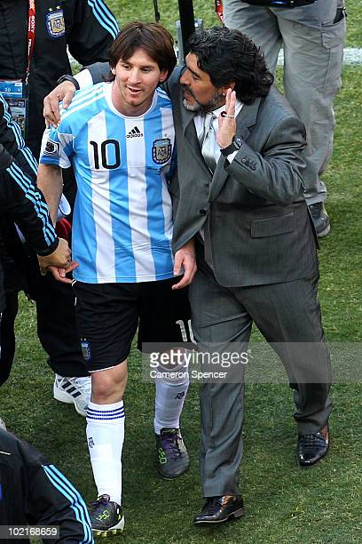 Diego Maradona head coach of Argentina talks with Lionel Messi of Argentina as they celebrate victory after the 2010 FIFA World Cup South Africa...