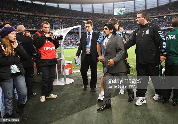 Diego Maradona head coach of Argentina walks to his daughter Dalma after the 2010 FIFA World Cup South Africa Quarter Final match between Argentina...