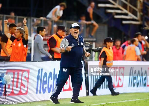 Diego Maradona head coach of Gimnasia y Esgrima La Plata celebrates after winning a match between Gimnasia y Esgrima La Plata and Atletico Tucuman as...