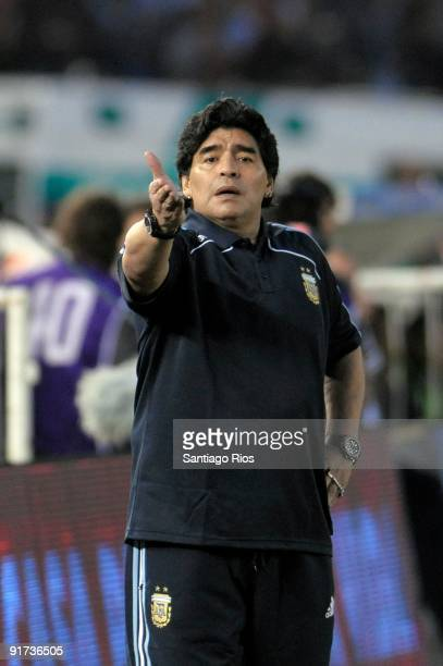 Diego Maradona headcoach of Argentina instructs the players during the match against Peru as part of the FIFA 2010 World Cup Qualifier at Monumental...