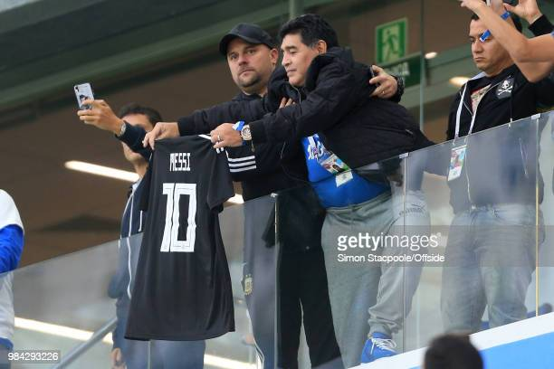 Diego Maradona holds up a Lionel Messi shirt before the 2018 FIFA World Cup Russia Group D match between Argentina and Croatia at the Nizhny Novgorod...