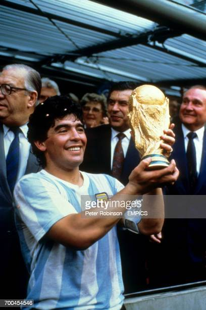 Diego Maradona holds up the World Cup trophy.