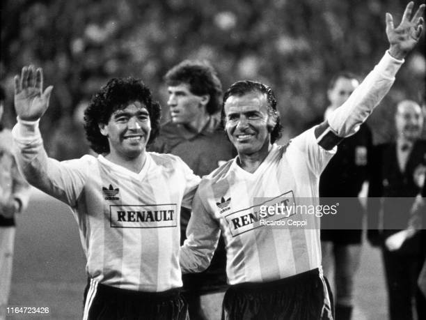 Diego Maradona hugs President of Argentina Carlos Menem before the start of a charity soccer match to raise funds for the poor on July 21 1989 in...