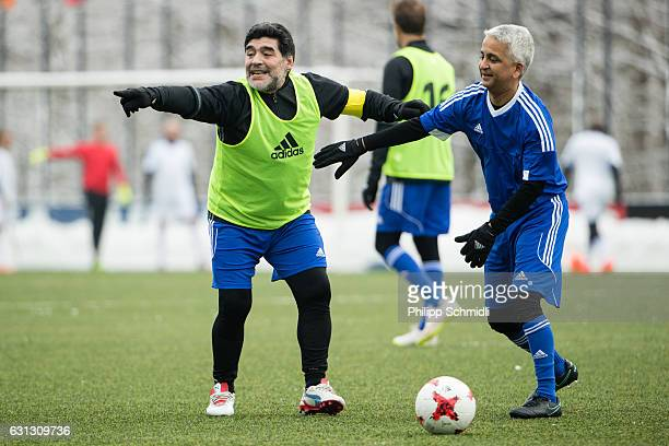 Diego Maradona jokes with FIFA Council member Sunil Gulati during a FIFA Team Friendly Football Match at the FIFA headquarters prior to The Best FIFA...