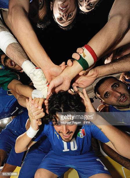 Diego Maradona Jr takes part in the Italian team huddle before the FIFA Beach Soccer World Cup Quarter Final match between Brazil and Italy at Umm...