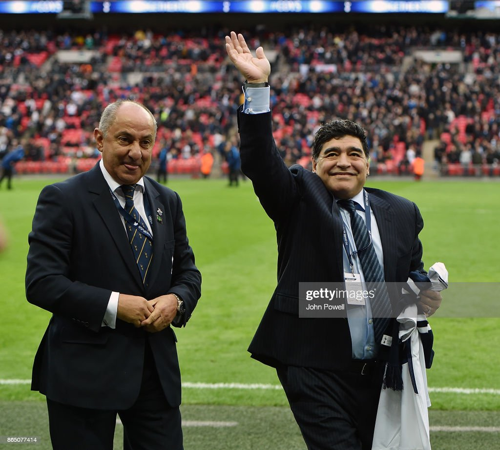 Diego Maradona legend of football with Ossie Ardiles legend of Tottenham Hotspur during the Premier League match between Tottenham Hotspur and Liverpool at Wembley Stadium on October 22, 2017 in London, England.