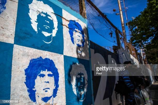 Diego Maradona mural is seen outside the stadium before a match between Gimnasia y Esgrima La Plata and Patronato as part of Liga Profesional de...