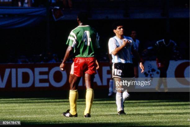 Diego Maradona of Argentina and Benjamin Massing of Cameroon during the opening match of the 1990 World Cup between Cameroon and Argentina at Stade...