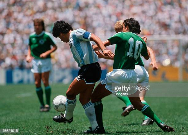 Diego Maradona of Argentina and Felix Magath of Germany in action during the World Cup final match between Argentina and Germany on June 29 1986 in...