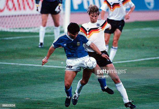 Diego Maradona of Argentina and Guido Buchwald of Germany battle for the ball during the World Cup final match between Argentina and Germany at the...
