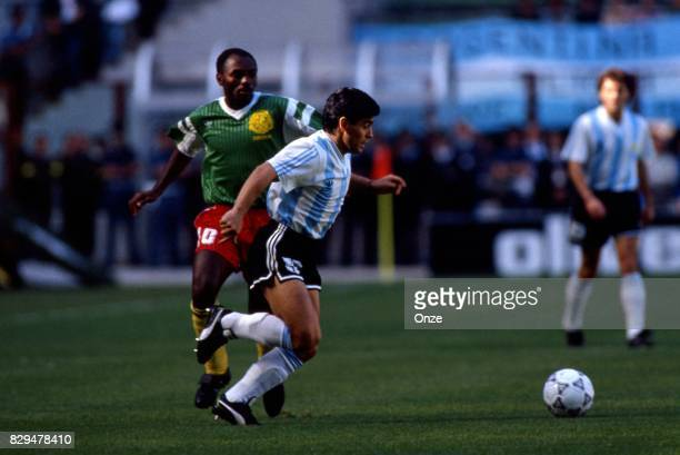Diego Maradona of Argentina and Louis Paul Mfede of Cameroon during the opening match of the 1990 World Cup between Cameroon and Argentina at Stade...