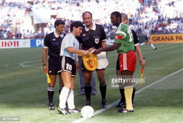 Diego Maradona of Argentina and Stephen Tataw of Cameroon with the referee during the opening match of the 1990 World Cup between Cameroon and...