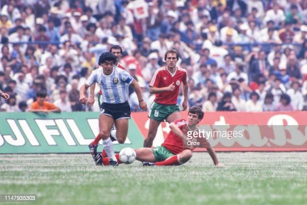 Diego Maradona of Argentina, Anio Sadakov and Nasko Sirakov of Bulgaria during the Group A World Cup 1986 match between Argentina and Bulgaria in...