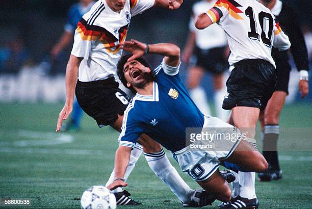 Diego Maradona of Argentina falls down after being fouled during the World Cup final match between Argentina and Germany at the Olympic Stadium on...