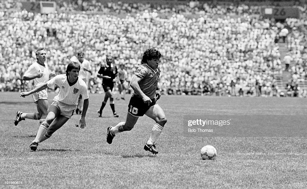 Diego Maradona of Argentina (right) goes past Terry Fenwick of England on his way to scoring Argentina's second goal during a World Cup Quarter-Final match held at the Azteca Stadium, Mexico City on 22nd June 1986. Argentina beat England 2-1. (Bob Thomas/Getty Images).