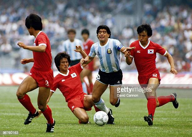 Diego Maradona of Argentina is fouled by players from the Republic of Korea during the Group A match at the 1986 FIFA World Cup on 2 June 1986 at the...