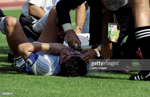Diego Maradona of Argentina is injured during a World Cup match in Italy Mandatory Credit Allsport UK /Allsport