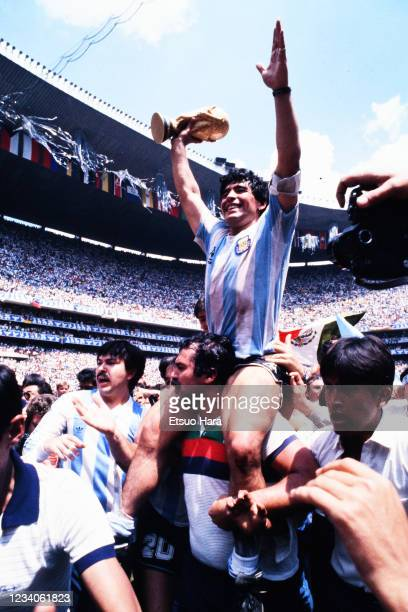 Diego Maradona of Argentina is lifted by his team mates and staffs after winning the FIFA World Cup Mexico final between Argentina and West Germany...