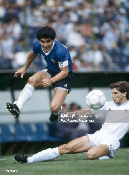 Diego Maradona of Argentina jumps over a tackle from Uruguay's Eduardo Acevedo during the FIFA World Cup match between Argentina and Uruguay at the...
