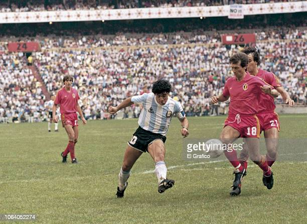 Diego Maradona of Argentina kicks the ball to score the first goal of his team during a 1986 FIFA World Cup Semi Final match between Argentina and...