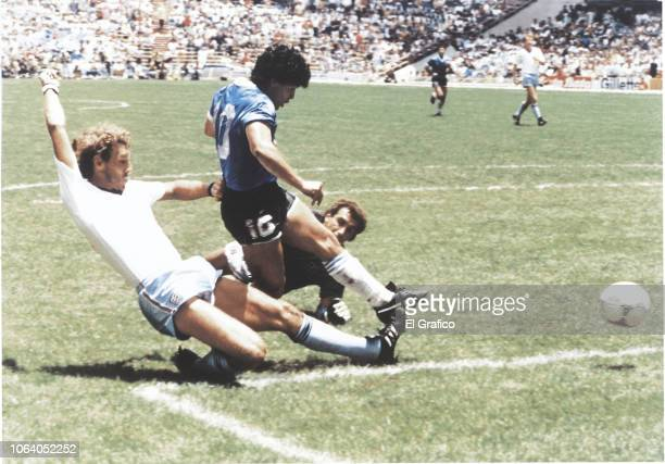 Diego Maradona of Argentina kicks the ball to score the second goal of his team during a 1986 FIFA World Cup Quarter Final match between Argentina...