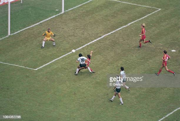 Diego Maradona of Argentina kicks the ball to score the second goal of his team during a 1986 FIFA World Cup Semi Final match between Argentina and...