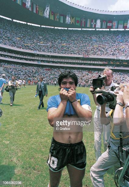 Diego Maradona of Argentina kisses his jersey after winning a 1986 FIFA World Cup Quarter Final match between Argentina and England at Azteca Stadium...