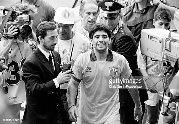 Diego Maradona of Argentina leaves the field wearing the shirt of Careca of Brazil after Argentina beat Brazil 10 in the Round of 16 during the FIFA...
