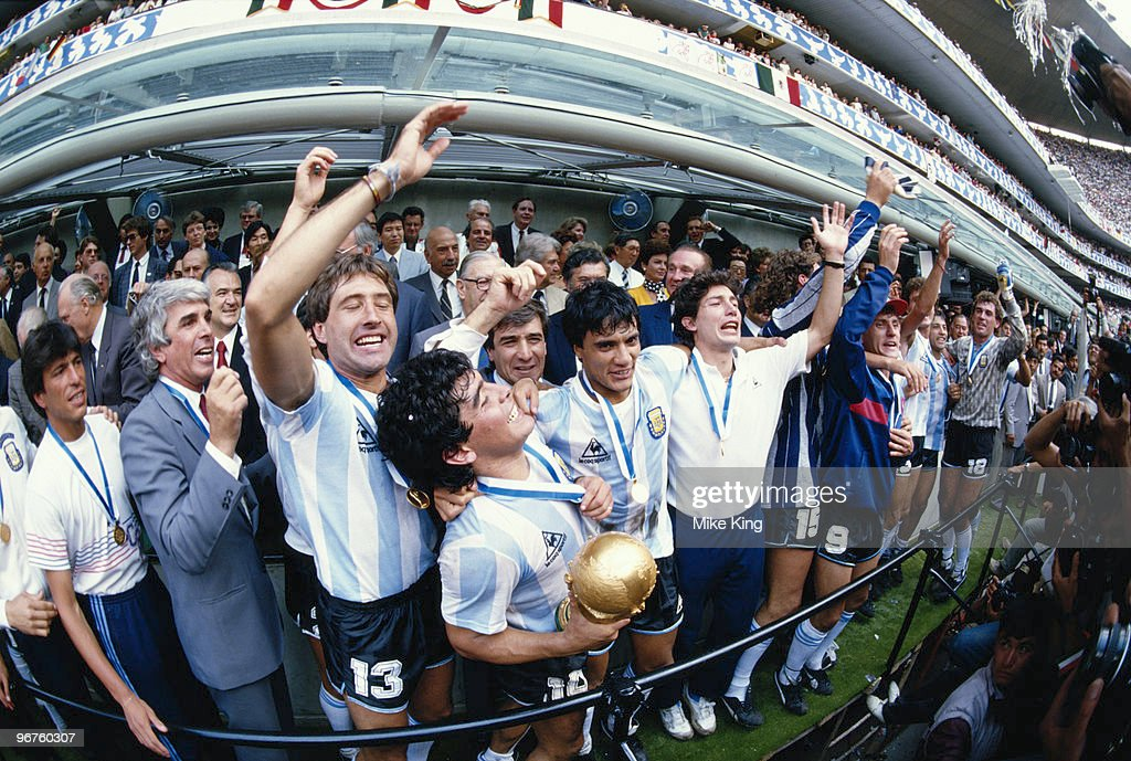 Diego Maradona of Argentina lifts the trophy and celebrates winning the FIFA World Cup final on 29 June 1986 against West Germany at the Azteca Stadium in Mexico City. Argentina won the match 3-2.