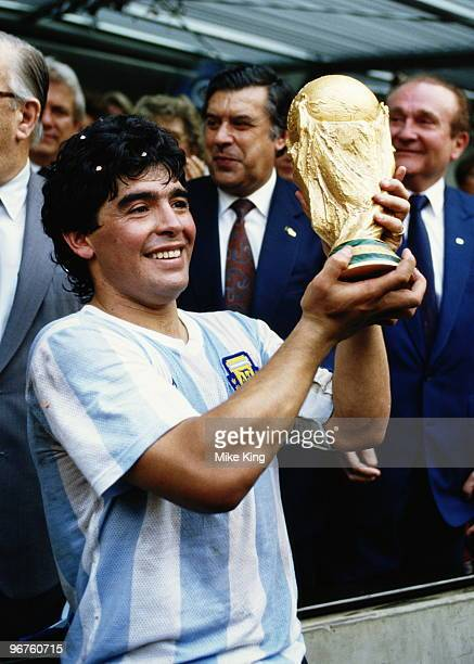 Diego Maradona of Argentina lifts the trophy and celebrates winning the FIFA World Cup final on 29 June 1986 against West Germany at the Azteca...