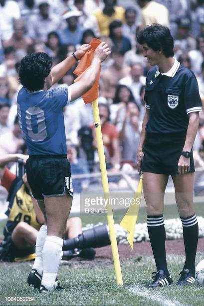 Diego Maradona of Argentina puts the flag back on the corner pole during a 1986 FIFA World Cup Quarter Final match between Argentina and England at...
