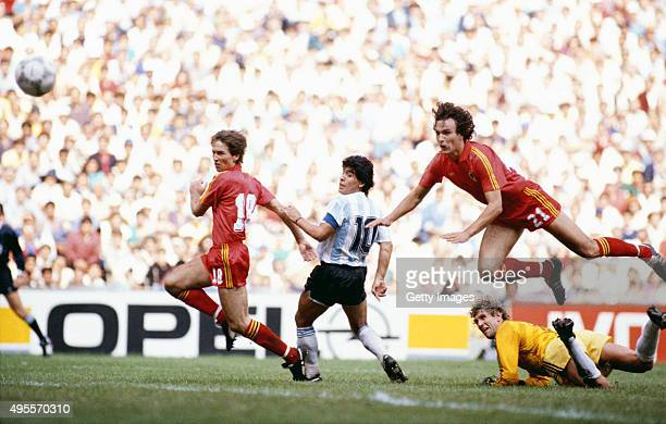 Diego Maradona of Argentina scores the first goal during the 1986 FIFA World Cup semi-final between Argentina and Belguim at the Azteca Stadium on...