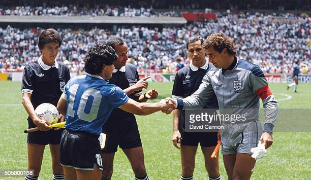 Diego Maradona of Argentina shakes hands with Peter Shilton of England under the watching eye of referee Ali Bin Nasser before the 1986 FIFA World...