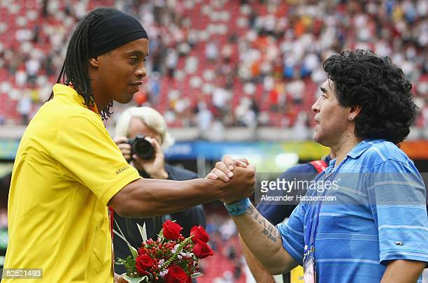 Diego Maradona of Argentina shakes the hand of Ronaldinho of Brazil during the medal ceremony for the Men's Football at the National Stadium on Day...