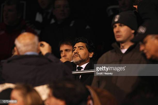 Diego Maradona of Argentina sits in the stands during the Barclays Premier League match between Fulham and Manchester City at Craven Cottage on...