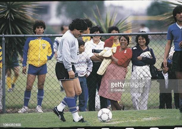 Diego Maradona of Argentina smiles during a training session ahead of the 1986 FIFA World Cup at Club America training camp on May, 1986 in Mexico...