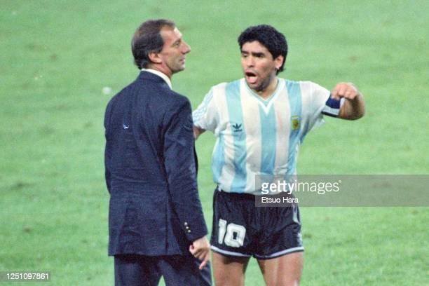 Diego Maradona of Argentina talks with head coach Carlos Bilardo during the FIFA World Cup Italy Semi Final match between Argentina and Italy at the...