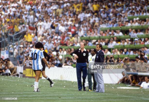 Diego Maradona of Argentina with his coach Tele Santana during the World Cup match between Argentina and Brazil in Stade de Saria at Barcelona on the...