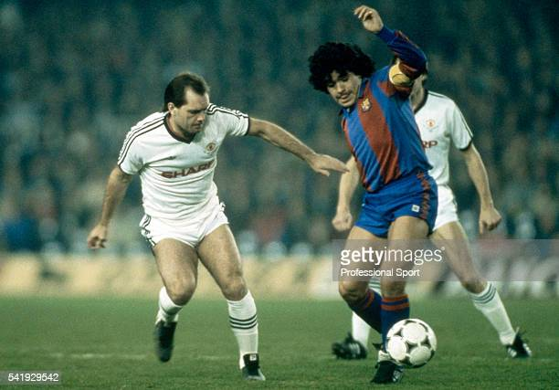 Diego Maradona of Barcelona is challenged by Ray Wilkins of Manchester United during the UEFA European Cup Winners Cup quarter final 1st leg at the...