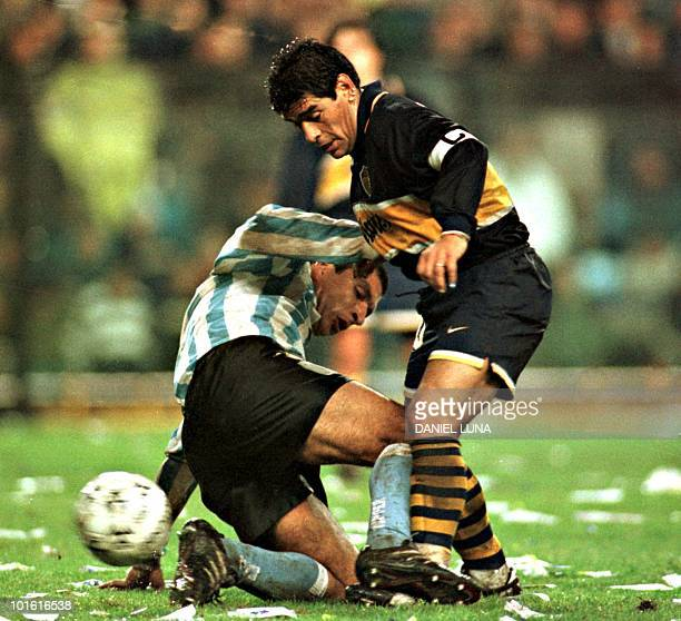 Diego Maradona of Boca Junior fights for control of the ball with Claudio Marini of Racing Club of Argentina 13 July in Buenos Aires during...