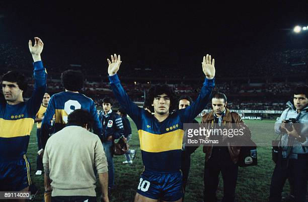 Diego Maradona of Boca Juniors with his arms raised after a match in Buenos Aires Argentina in 1981