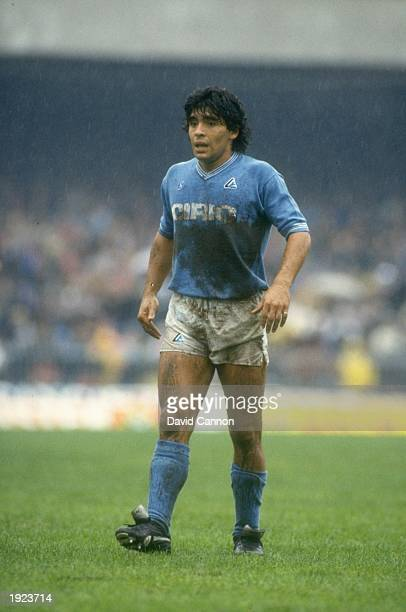 Diego Maradona of Napoli SSC rests during an Italian League match against AC Milan at the San Paolo Stadium in Naples, Italy. The match ended in a...