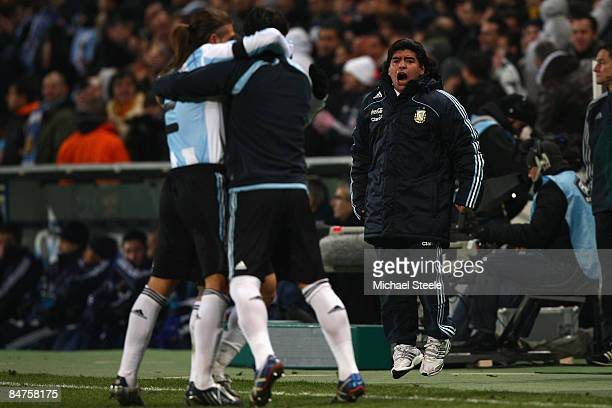 Diego Maradona the Argentina coach celebrates his sides second goal during the International Friendly match between France and Argentina at the Stade...
