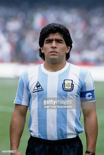 Diego Maradona the Argentine soccer captain listens to national anthems being played before the start of a World Cup match