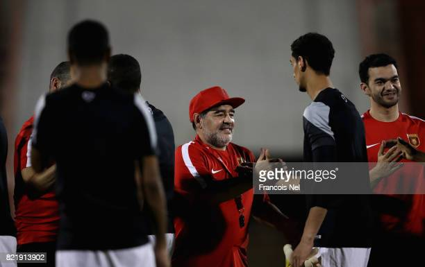 Diego Maradona the new head coach of Fujairah FC speaks to players during a training session at Fujairah Stadium on July 24 2017 in Fujairah United...