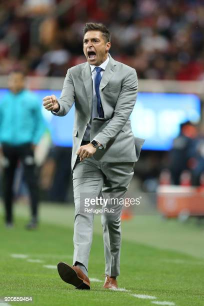 Diego Martin Alonso coach of Pachuca gives instructions to his players during the 8th round match between Chivas and Pachuca as part of the Torneo...