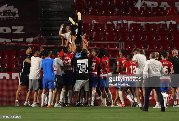 Diego Martinez manager of Granada is thrown into the air by his players after they qualify for the Europa League during the Liga match between...
