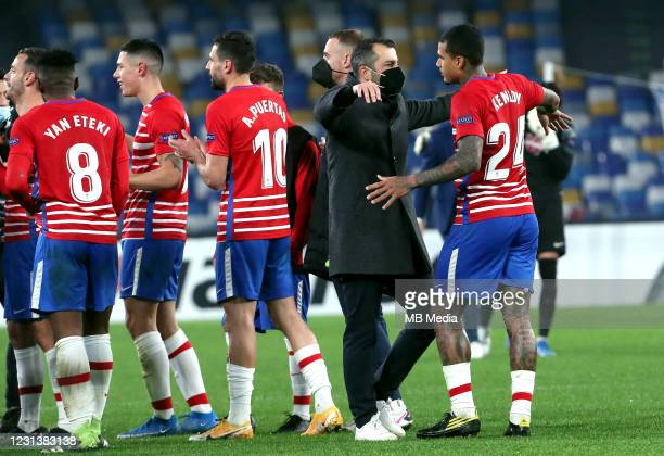 Diego Martínez Head Coach of Granada CF celebrates with his players for the qualyfing after the UEFA Europa League Round of 32 match between SSC...