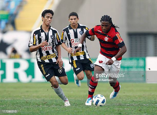 Diego Mauricio of Flamengo brings the ball up field while being defended by Lucas Zen of Botafogo during a match as part of the Brazilian...
