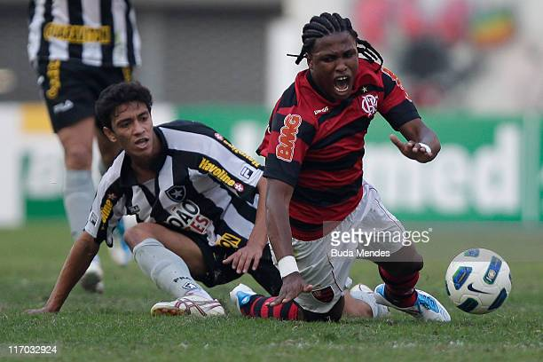Diego Mauricio of Flamengo struggles for the ball with a player of Botafogo during a match as part of Brazilian Championship Serie A at Engenhao...